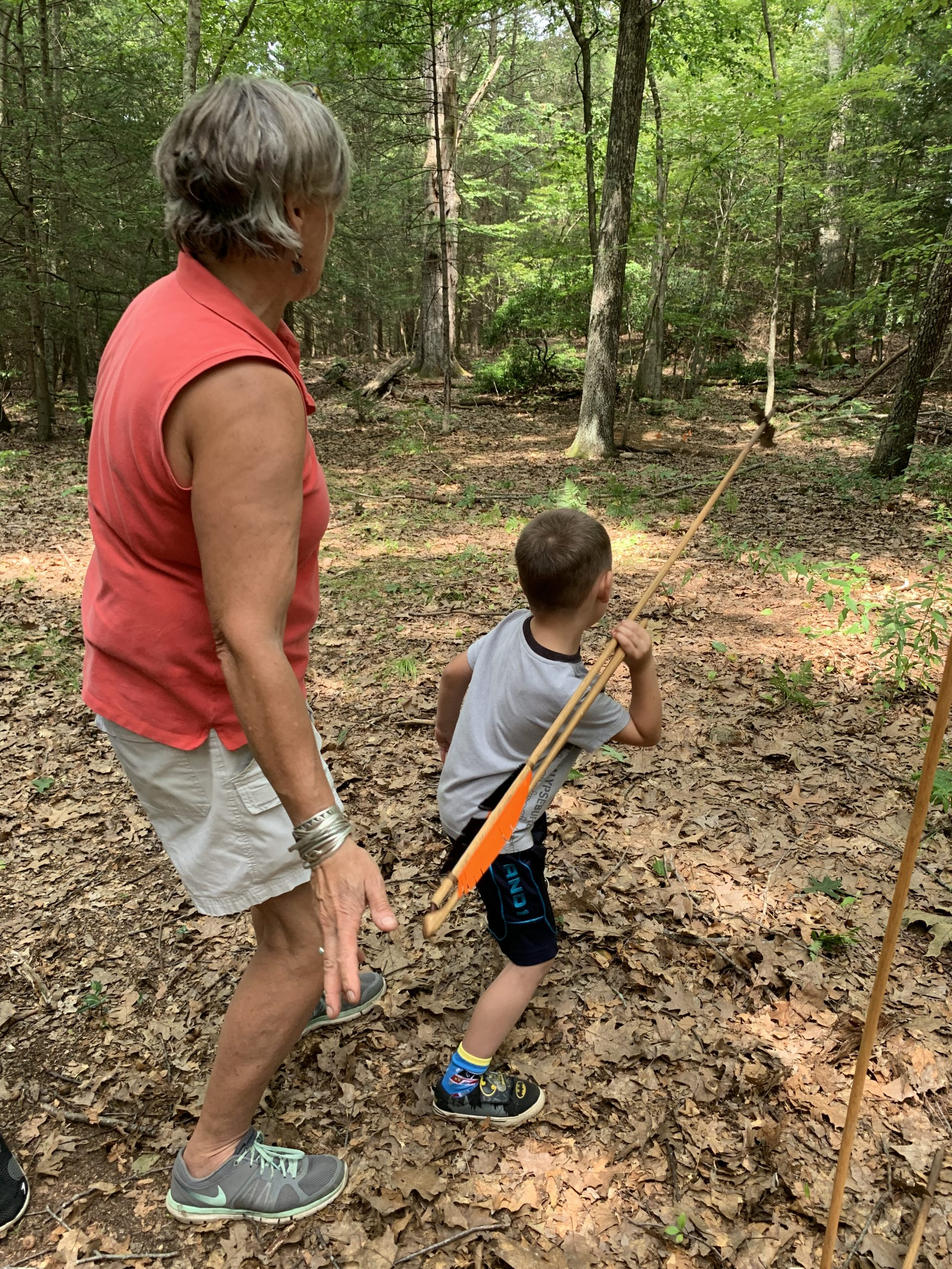Child using atlatl in the Connecticut woodlands